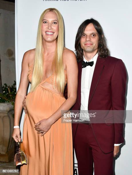Stylist Djuna Bel and artist Nikolai Haas attend the amfAR Gala at Ron Burkle's Green Acres Estate on October 13 2017 in Beverly Hills California