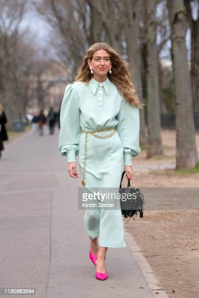 Stylist Emili Sindlev wears a Rowen Rose dress and shoes, Valentino bag and a Chanel belt on March 03, 2019 in Paris, France.