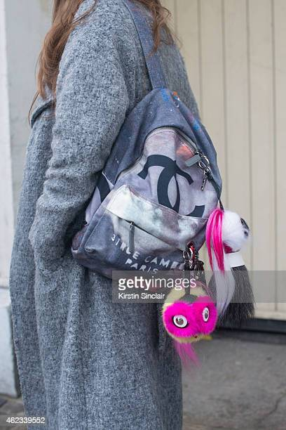 Stylist Estelle Pigault wears a River Island coat and Chanel backpack on day 2 of Paris Haute Couture Fashion Week Spring/Summer 2015 on January 26...
