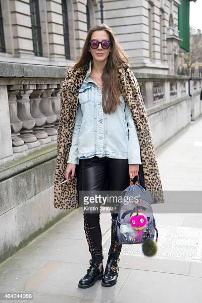 21b71ec1f4d0 Stylist Estelle Pigault wears Forever 21 coat Fendi accessories Valentino  boots New Look sunglasses and Zara