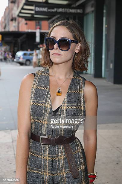 Stylist Gabrielle Swan is wearing romper by Tucker by Gaby Basora shoes by ZARA sunglasses by Balenciaga and jewelry by Alexis Bittar and Aesa as...