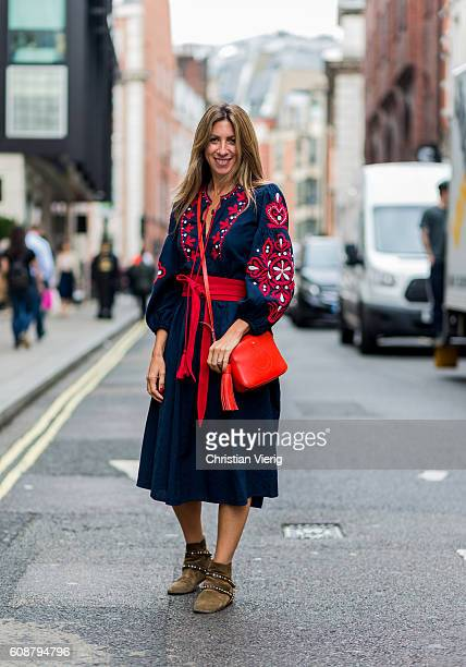 Stylist Gayle Rinkoff wearing a navy dress and red bag during London Fashion Week Spring/Summer collections 2017 on September 19 2016 in London...