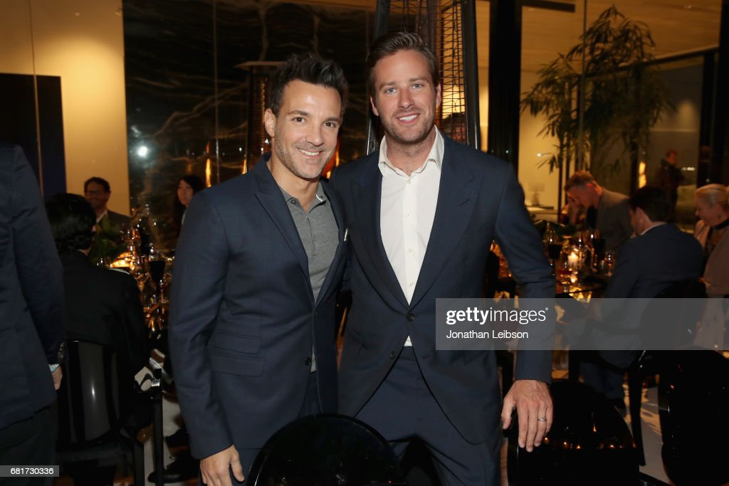 Stylist George Kotsiopoulos (L) and host Armie Hammer attend the private Hennessy X.O on Ice dinner, in Beverly Hills, CA on May 10, 2017. The dinner served to unveil Hennessy X.O's new 3-D printed ice bucket designed by architect Paul McClean. The ice bucket encourages serving Hennessy X.O, the world's original Extra Old Cognac, on ice to best enjoy the spirit's multisensory taste odyssey.