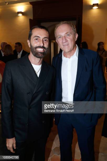 Stylist Giambattista Valli and CEO of Kering Group FrancoisHenri Pinault attend the Kering Heritage Days Opening Night at 40 Rue de Sevres on...