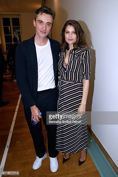 Stylist Guillaume Henry and Laetitia Casta pose Backstage after the Nina Ricci show as part of the Paris Fashion Week Womenswear Spring/Summer 2017...