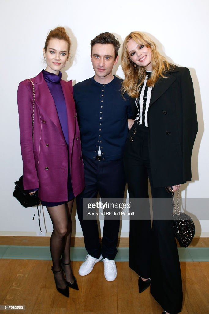 Stylist Guillaume Henry standing between 'Egeries de Nina Ricci', Frida Gustavsson (L) and Jac Jagaciak (R) pose backstage after the Nina Ricci show as part of the Paris Fashion Week Womenswear Fall/Winter 2017/2018 on March 4, 2017 in Paris, France.