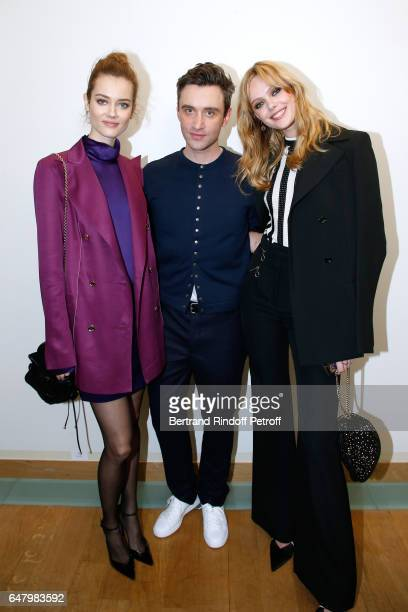 Stylist Guillaume Henry standing between 'Egeries de Nina Ricci' Frida Gustavsson and Jac Jagaciak pose backstage after the Nina Ricci show as part...