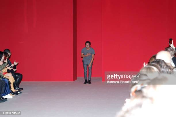 Stylist Haider Ackermann acknowledges the applause of the audience at the end of the Haider Ackermann show as part of the Paris Fashion Week...