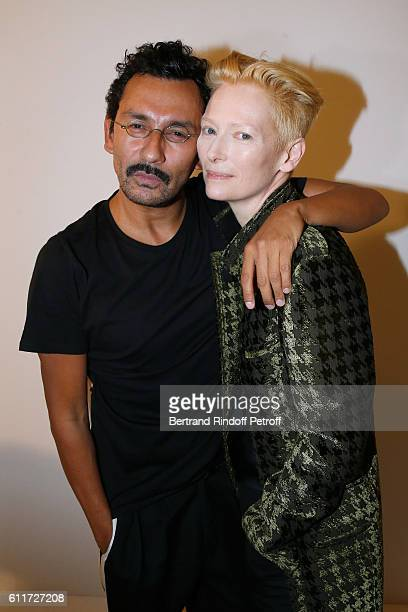 Stylist Haider Ackermann and actress Tilda Swinton pose Backstage after the Haider Ackermann show as part of the Paris Fashion Week Womenswear...