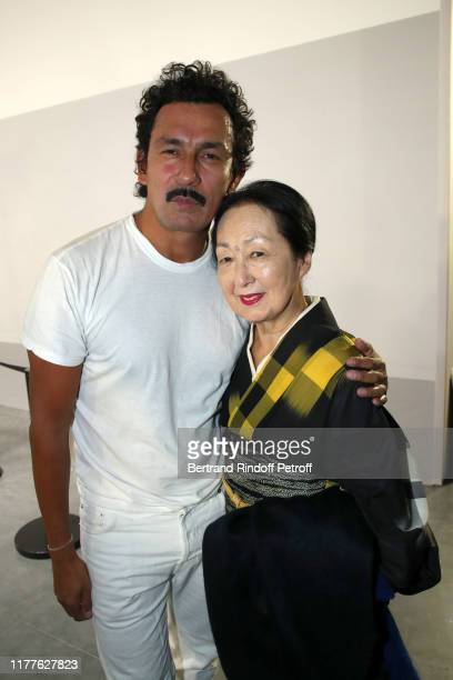 Stylist Haider Ackermann and artist Setsuko Klossowska de Rola pose after the Haider Ackermann Womenswear Spring/Summer 2020 show as part of Paris...