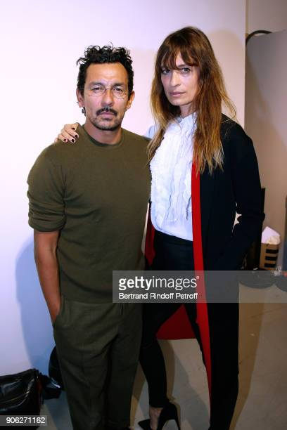 Stylist Haider Ackermann and Caroline de Maigret pose after the Haider Ackermann Menswear Fall/Winter 20182019 show as part of Paris Fashion Week on...