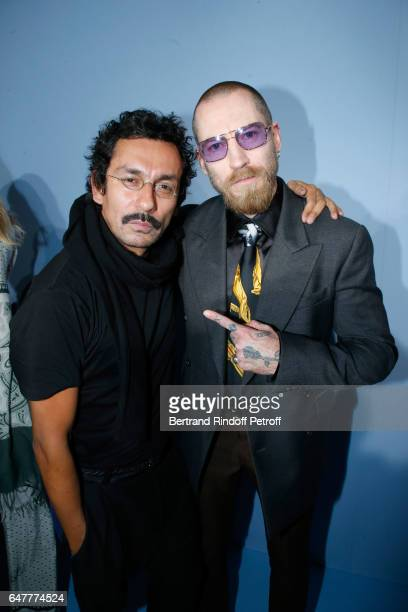 Stylist Haider Ackermann and Justin O'shea pose backstage after the Haider Ackermann show as part of the Paris Fashion Week Womenswear Fall/Winter...