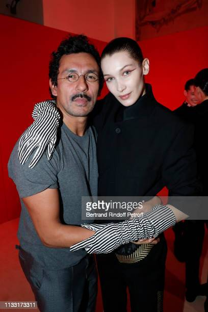 Stylist Haider Ackermann and model Bella Hadid pose after the Haider Ackermann show as part of the Paris Fashion Week Womenswear Fall/Winter...