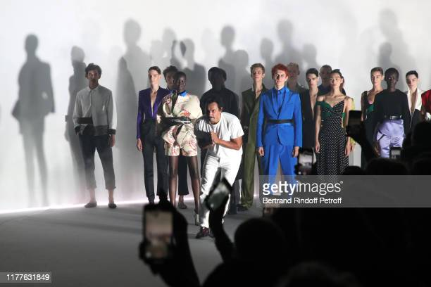 Stylist Haider Ackermann and models acknowledge the applause of the audience at the end of the Haider Ackermann Womenswear Spring/Summer 2020 show as...