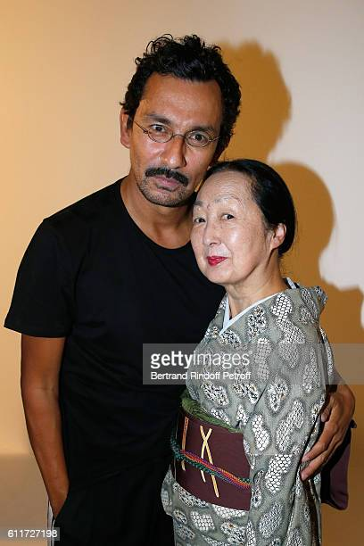 Stylist Haider Ackermann and Setsuko Klossowska de Rola pose Backstage after the Haider Ackermann show as part of the Paris Fashion Week Womenswear...