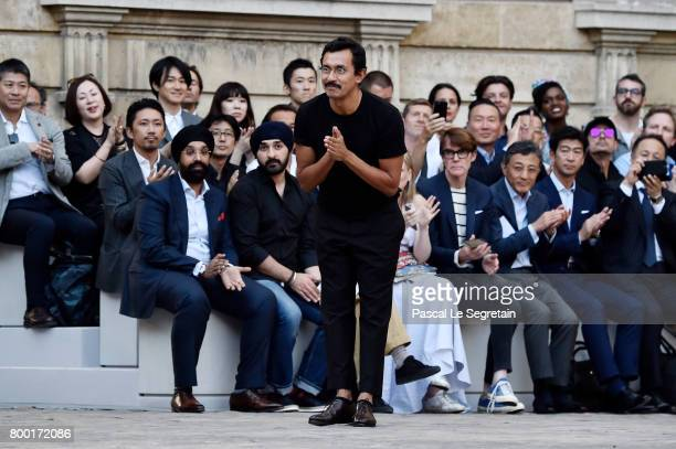 Stylist Haider Ackermann greets the crowd on the runway during the Berluti Menswear Spring/Summer 2018 show as part of Paris Fashion Week on June 23...