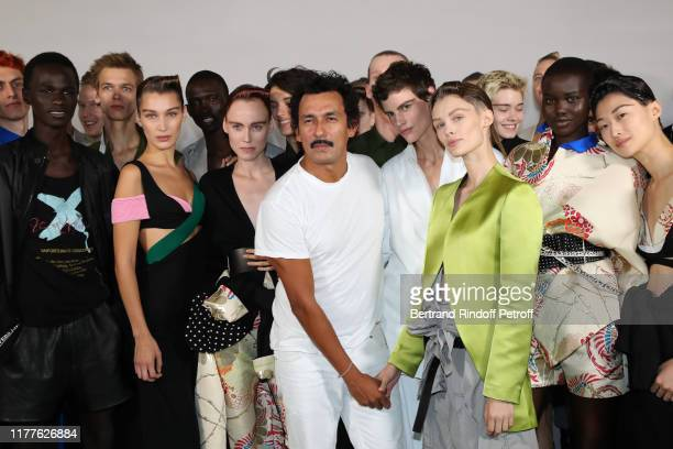Stylist Haider Ackermann poses with his models whose Bella Hadid after the Haider Ackermann Womenswear Spring/Summer 2020 show as part of Paris...