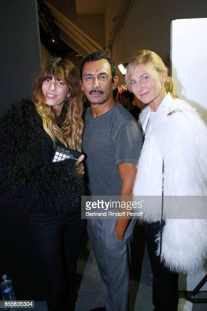 Stylist Haider Ackermann standing between Elizabeth von Guttman and Lou Doillon both dressed in Haider Ackermann pose Backstage after the Haider...