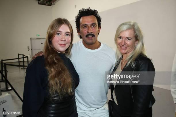 Stylist Haider Ackermann standing between Renate Kiefer and her daughter Elektra pose after the Haider Ackermann Womenswear Spring/Summer 2020 show...