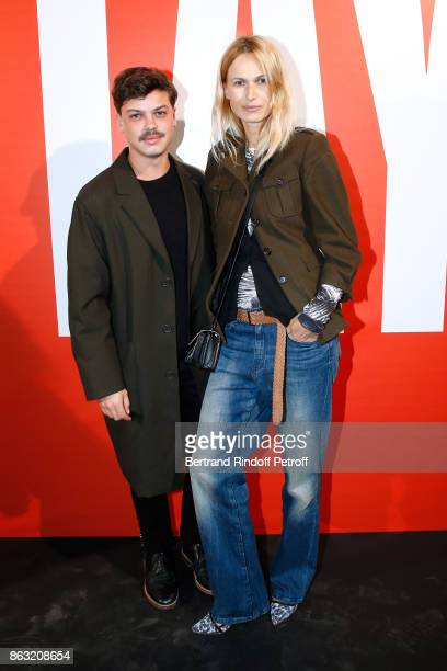 Stylist Hugo Matha and a Model attend the Art Exhibition Reflexion Redux of Benjamin Millepied and Barbara Kruger at Studio des Acacias on October 19...