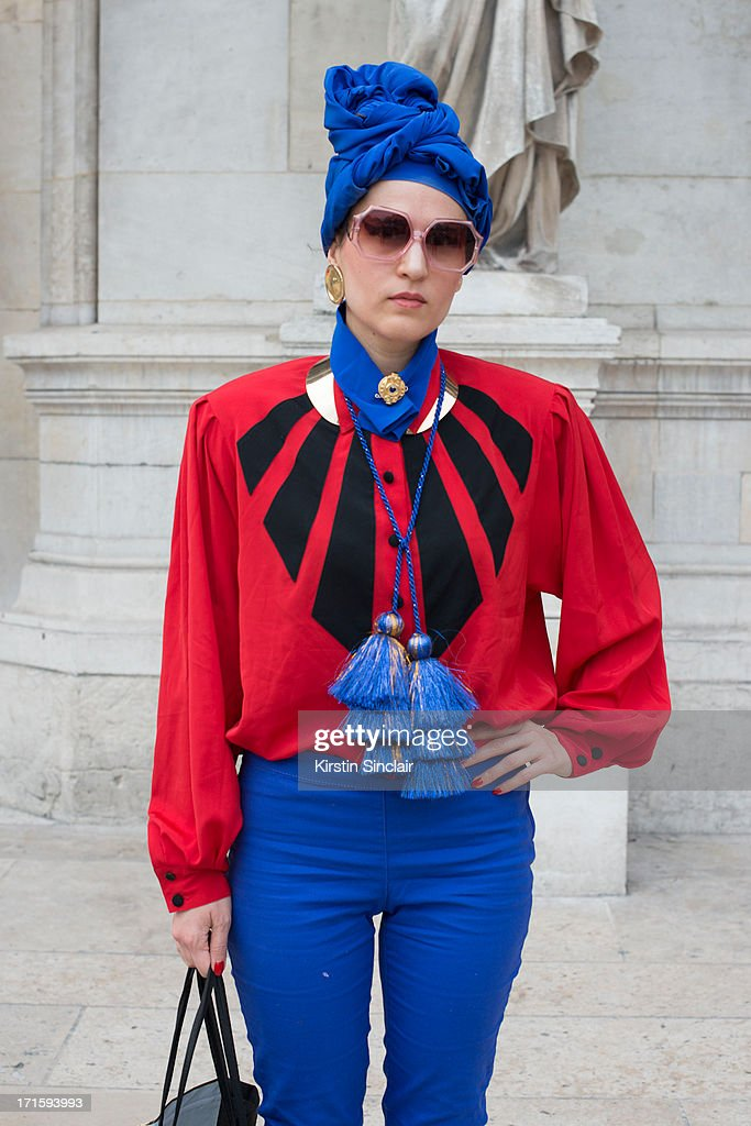 Stylist Isobel Felmer wears H and M trousers, Louis Ferand shirt, vintage sunglasses and a hat she made herself on day 1 of Paris Collections: Men on June 26, 2013 in Paris, France.