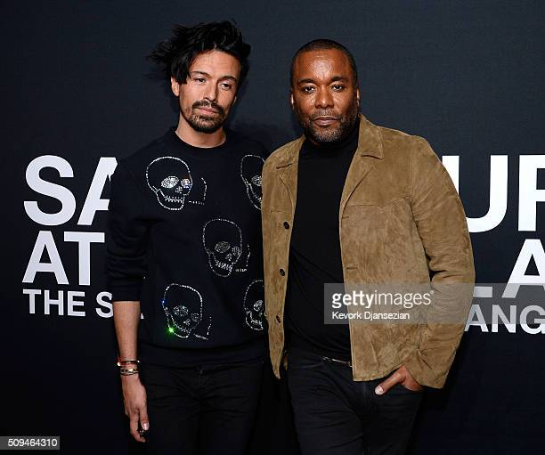 Stylist Jahil Fisher and Director/Producer Lee Daniels attend the Saint Laurent show at The Hollywood Palladium on February 10 2016 in Los Angeles...