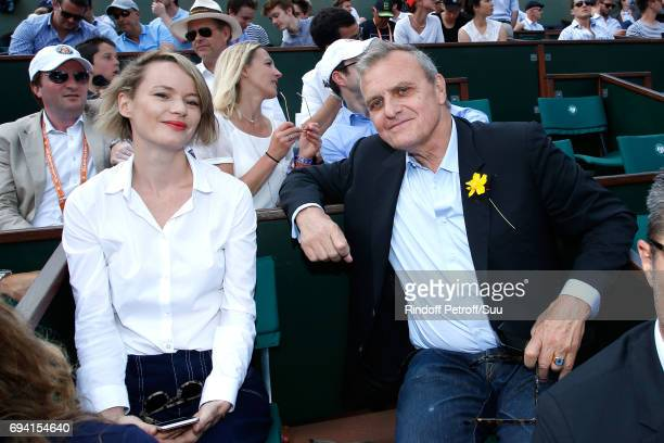 Stylist JeanCharles de Castelbajac and guest attend the 2017 French Tennis Open Day Thirteen at Roland Garros on June 9 2017 in Paris France