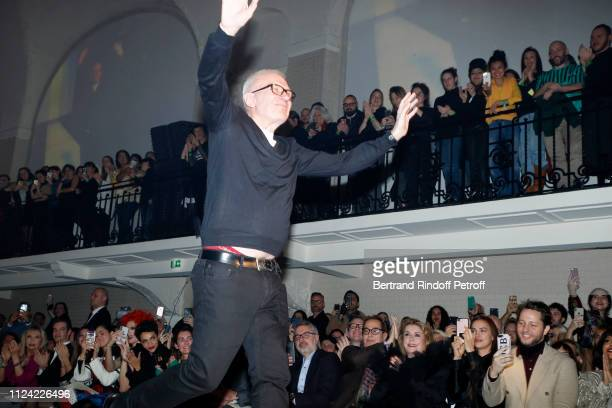 Stylist JeanPaul Gaultier acknowledges the applause of the audience at the end of the show in front of Amanda Lear a guest Iris Mittenaere Chompoo...