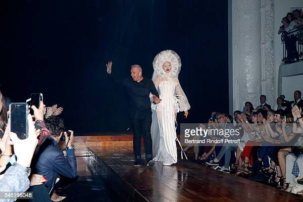 Stylist JeanPaul Gaultier and his Married Model acknowledge the applause of the audience at the end of the Jean Paul Gaultier Haute Couture...
