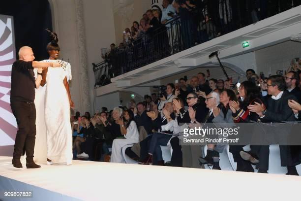 Stylist JeanPaul Gaultier walks and Model walk the runway in front of Amanda Lear Cristina Cordula Vincent Dedienne Iris Mittenaere Anggun Gerard...