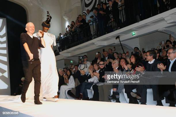 Stylist JeanPaul Gaultier walks and Model walk the runway in front of Anggun Gerard Jugnot his wife Patricia Campi First Model of Pierre Cardin...