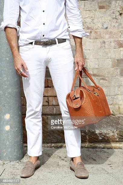 Stylist Jeff Lack wearing Persol sunglasses vintage bag Acme pants Brad Wilson shirt and Aquila shoes at MercedesBenz Fashion Week Australia 2014 at...