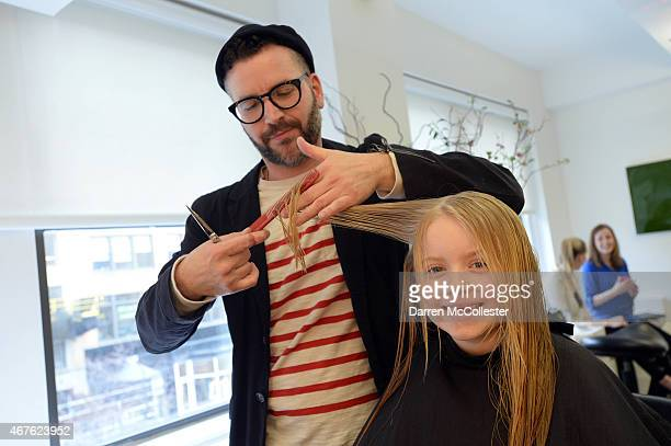Stylist Jesse Blodgett gives Annika a haircut to kick off HAIRraising to support Boston Children's Hospital at Salon Mario Russo March 26 2015 in...