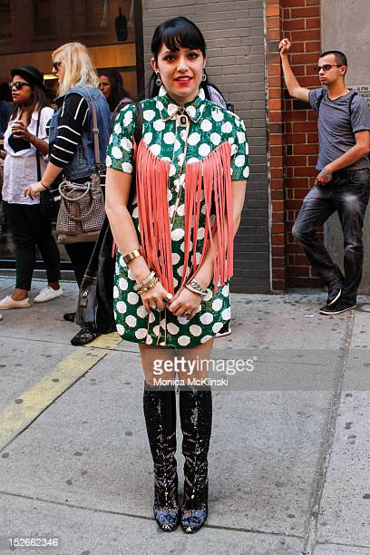 Stylist Jessica Bosch seen wearing an Ashish dress Anna Sui boots and Versace bag outside the Jeremy Scott showing at Milk Studios at Streets of...