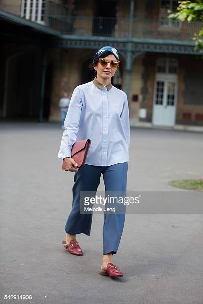 Stylist Julie Ragolia enters the Givenchy show in Gucci furlined loafers during Paris Fashion Week Men's SS17 on June 24 2016 in Paris France