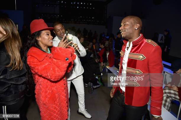 Stylist June Ambrose recording artist Young Paris and a guest attend the Laquan Smith front row during New York Fashion Week The Shows at Gallery I...