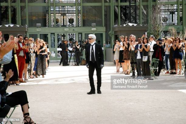 Stylist Karl Lagerfeld acknowledges the applause of Cara Delevingne Aziz Ansari Alessandra Mastronardi and all the audience at the end of the Chanel...