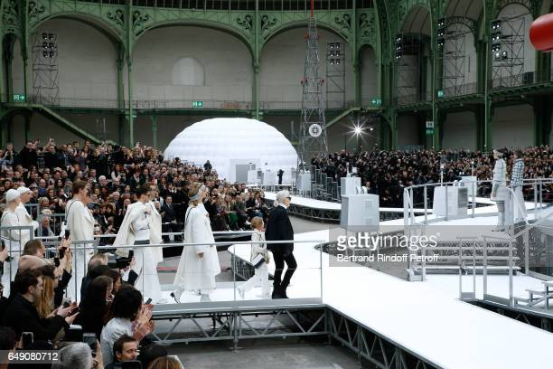 Stylist Karl Lagerfeld and his Godson Hudson Kroenig acknowledge the applause of the audience at the end of the Chanel show as part of the Paris...