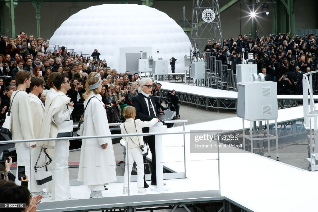 Stylist Karl Lagerfeld and his Godson Hudson Kroenig walk the runway at the end of the Chanel show as part of the Paris Fashion Week Womenswear Fall/Winter 2017/2018 on March 7, 2017 in Paris, France.