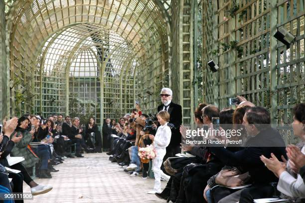 Stylist Karl Lagerfeld and his Godson Hudson Kroenig walk the runway at the end of the Chanel Haute Couture Spring Summer 2018 show as part of Paris...