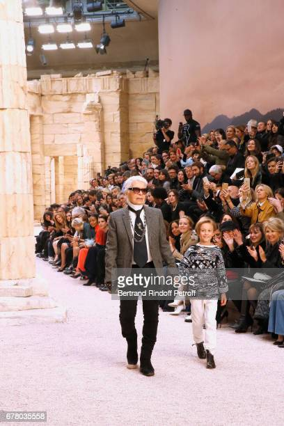 Stylist Karl Lagerfeld and his nephew Hudson Kroenig walk the runway during the Chanel Cruise 2017/2018 Collection Show at Grand Palais on May 3 2017...