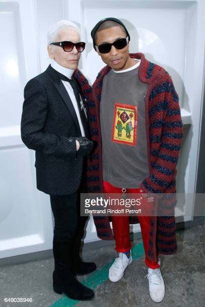 Stylist Karl Lagerfeld and Pharrell Williams attend the Chanel show as part of the Paris Fashion Week Womenswear Fall/Winter 2017/2018 on March 7...