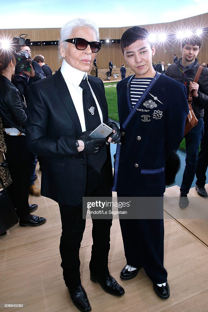 Stylist Karl Lagerfeld and Singer G-Dragon pose after the Chanel Spring Summer 2016 show as part of Paris Fashion Week on January 26, 2016 in Paris, France.