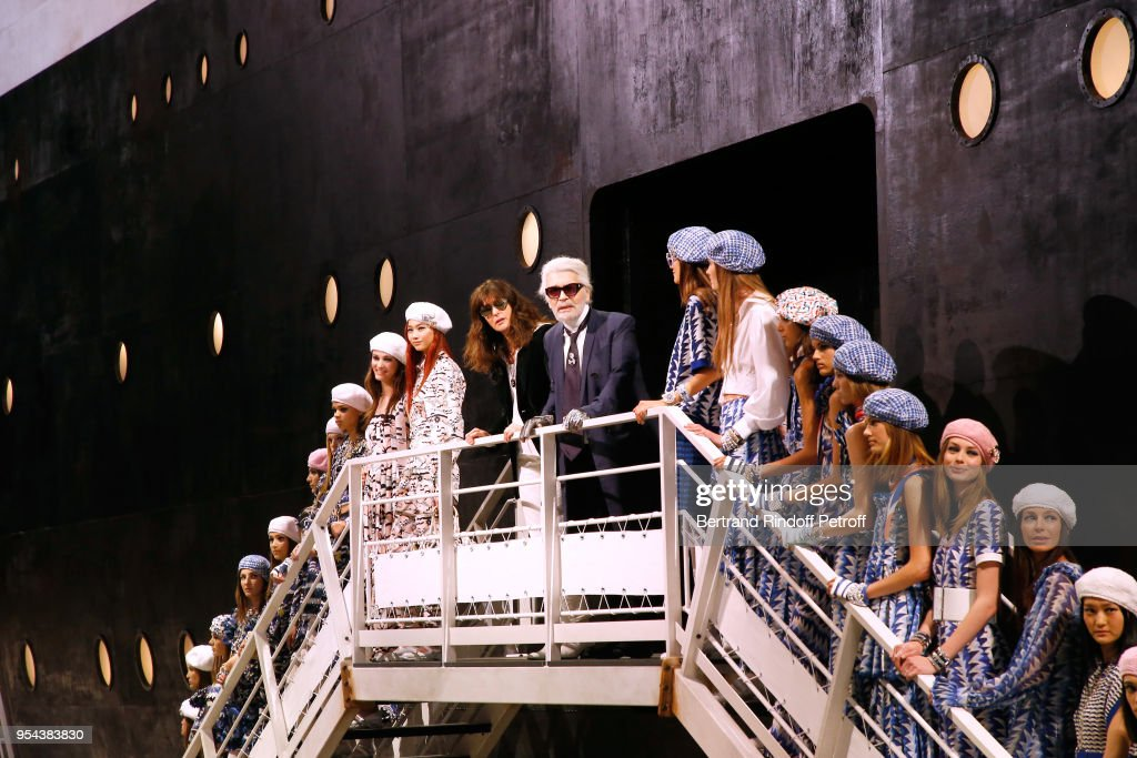 Stylist Karl Lagerfeld, director of Chanel creative studio Virginie Viard and models pose at the end of the Chanel Cruise 2018/2019 Collection at Le Grand Palais on May 3, 2018 in Paris, France.