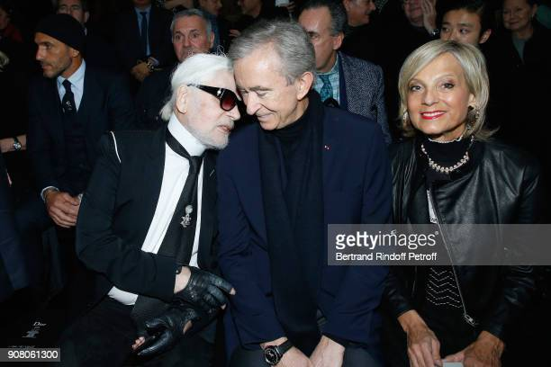 Stylist Karl Lagerfeld owner of LVMH Luxury Group Bernard Arnault and his wife Helene MercierArnault attend the Dior Homme Menswear Fall/Winter...