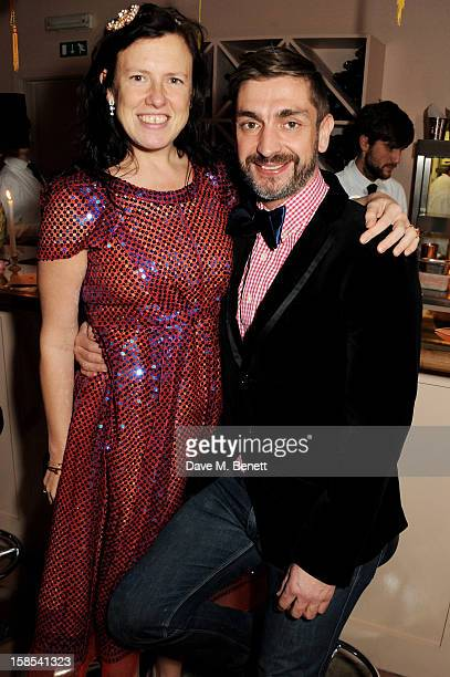 Stylist Katie Grand and David Waddington attend the Katie Grand Olivier Rousteing LOVE Christmas Party hosted by Balmain at Shrimpy's on December 18...