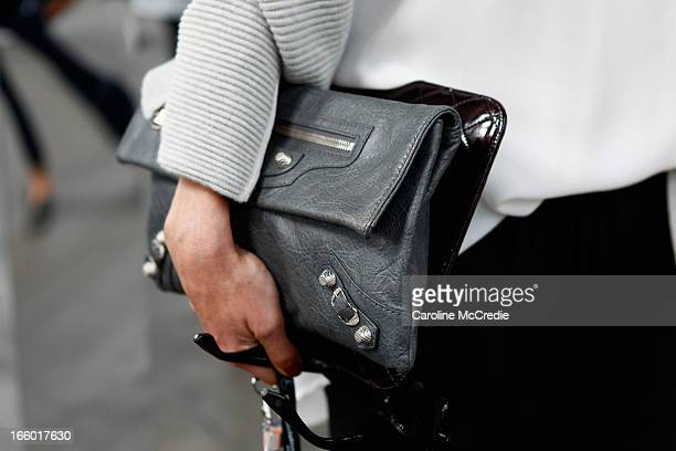 Stylist Kelly Smythe, wearing a Phillip Lim jacket, Balenciaga handbag and gucci shoes, attends the Christopher Esber show during Mercedes-Benz...
