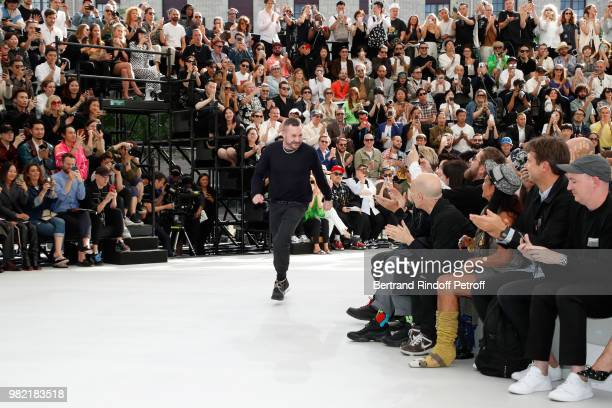 Stylist Kim Jones acknowledges the applause of the audience at the end of the Dior Homme Menswear Spring/Summer 2019 show as part of Paris Fashion...