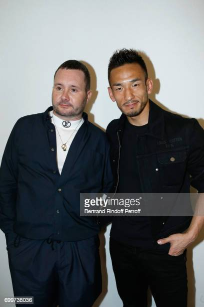 Stylist Kim Jones and Football player Hidetoshi Nakata pose after the Louis Vuitton Menswear Spring/Summer 2018 show as part of Paris Fashion Week on...
