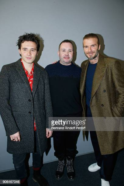Stylist Kim Jones standing between David Beckham and his son Brooklyn Beckham pose after the Louis Vuitton Menswear Fall/Winter 20182019 show as part...